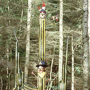 carved wooden totems, totem poles